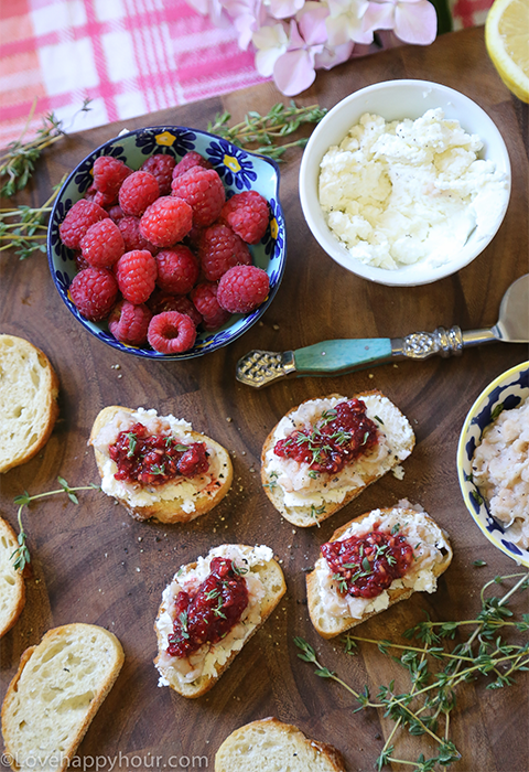 Smashed Raspberry and Goat Cheese Crostinis by Maren Swanson. #appetizer #recipe #goatcheese #raspberry #crostini @lovehappyhour