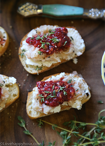 Smashed Raspberry and Goat Cheese Crostinis