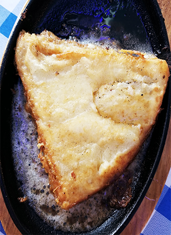 Saganaki at Delphi Greek restaurant in Westwood.
